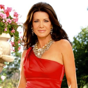 Here is one of the stunning  Beverly Hills Real Housewives from the series of the same name, shot on her way to wherever.